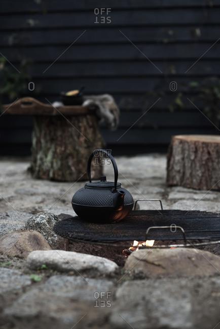 Making tea in a kettle outside on open fire