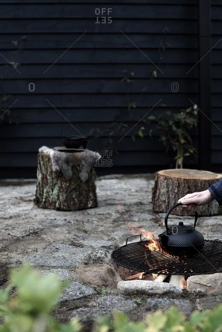 Making tea in a black kettle outside on open fire