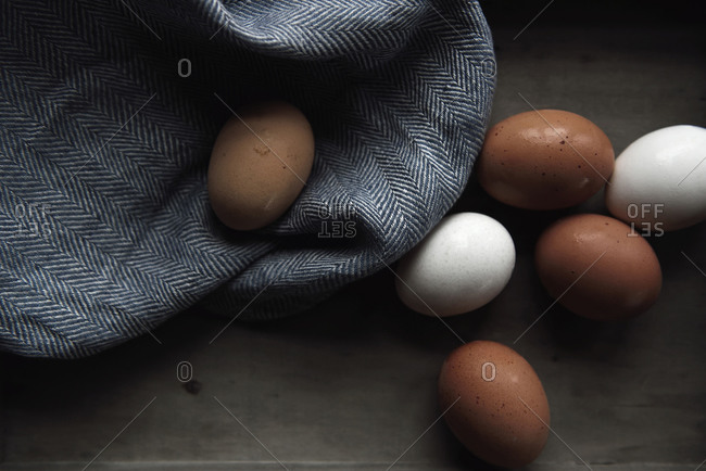 Close up of eggs on a wooden tray on gray background