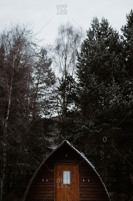 Residential cabin house with wooden facade located in village in winter in Scottish Highlands