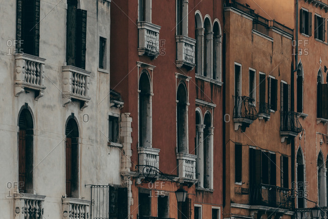 Old residential buildings with grungy exterior and arched ornate windows located in Venice