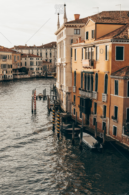 August 16, 2019: Cityscape of Venice with water canal and old buildings with weathered facade in morning