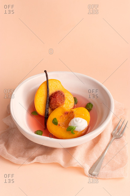 Poached Peaches in white wine, vanilla and basil.