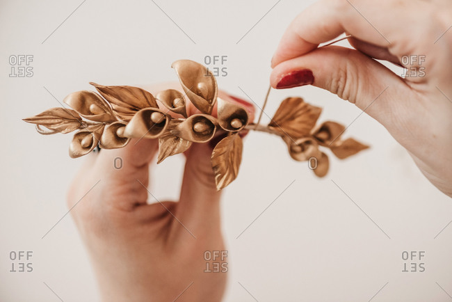 Unrecognizable crop talented craftswoman making decorative flowers in workshop while working on project