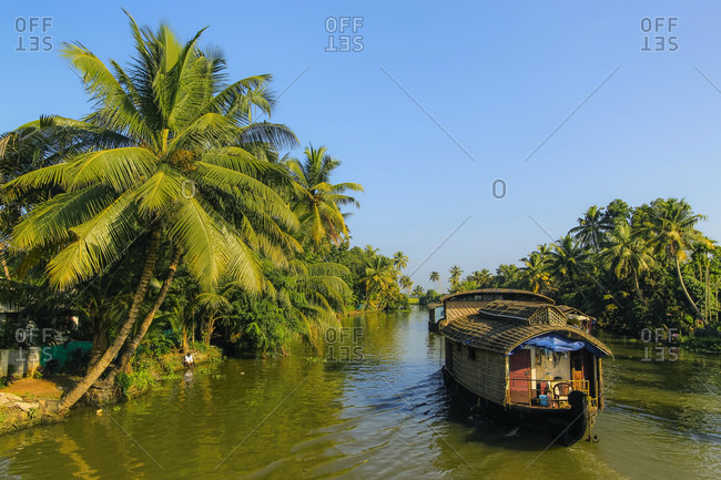 Kerala houseboat cruising the palm fringed backwaters on a typical tourist cruise, Alappuzha (Alleppey), Kerala, India, Asia