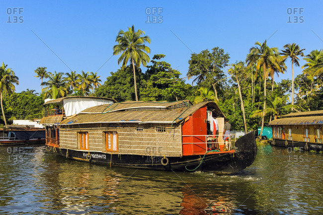 October 19, 2017: Kerala houseboat, an old rice, spice or goods barge converted for popular backwater cruises, Alappuzha (Alleppey), Kerala, India, Asia