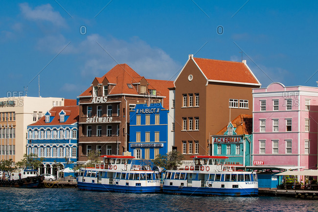March 14, 2018: Colorful buildings, architecture in capital city Willemstad, UNESCO World Heritage Site, Curacao, ABC Islands, Dutch Antilles, Caribbean, Central America