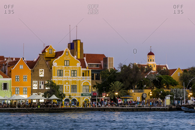 March 15, 2018: Colorful buildings, architecture in capital city Willemstad, UNESCO World Heritage Site, Curacao, ABC Islands, Dutch Antilles, Caribbean, Central America