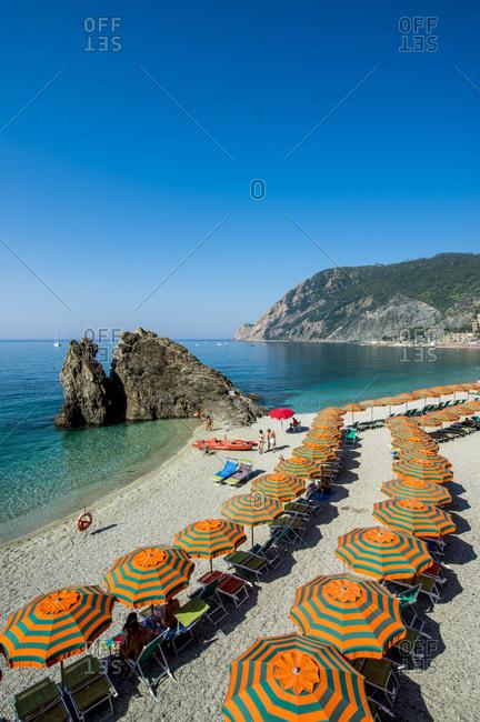 June 24, 2016: Beach umbrellas lining the beach in Monterosso al Mare, Cinque Terre, UNESCO World Heritage Site, Liguria, Italy, Europe