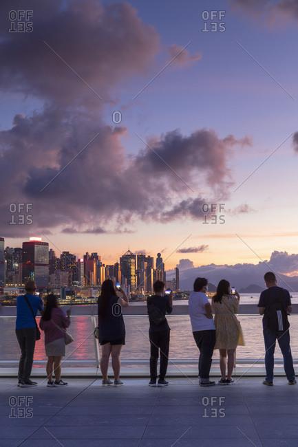 June 28, 2020: People watching sunset from Harbor City, Hong Kong, China, Asia