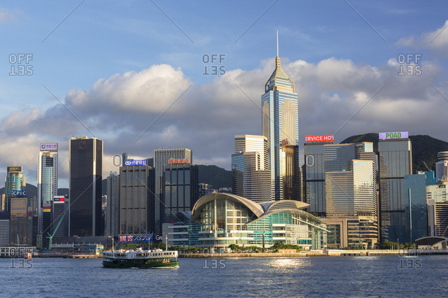August 9, 2020: Star Ferry in Victoria Harbor with skyscrapers of Wan Chai, Hong Kong, China, Asia