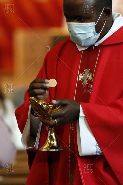 May 31, 2020: Coronavirus epidemic (Covid-19), Celebration of the Pentecost Mass after lockdown, Holy Communion, Saint Louis de Novel Church, Annecy, Haute Savoie, France, Europe
