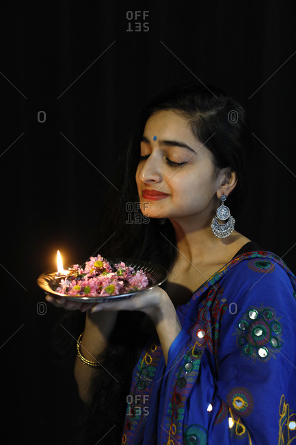 March 9, 2020: Indian dancer holding a Diwali tray, Paris, France, Europe