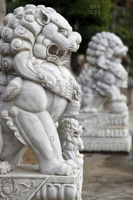 December 2, 2019: Long Khanh Buddhist Pagoda, Imperial guardian lion statue at entrance, Quy Nhon, Vietnam, Indochina, Southeast Asia, Asia