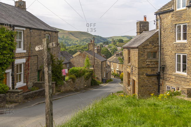 View of stone houses in the village of Hayfield, High Peak, Derbyshire, England, United Kingdom, Europe