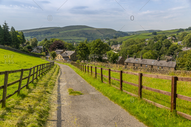 View of Hayfield including St. Mathews Church and hills surrounding village, High Peak, Derbyshire, England, United Kingdom, Europe