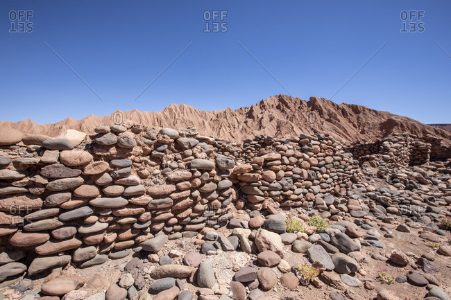 Remnants of rock structures in Tambo de Catarpe, Catarpe Valley in the Atacama Desert, Chile, South America