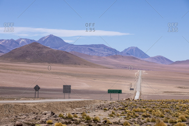 Highway going through stratovolcanoes in the Andean Central Volcanic Zone, Antofagasta Region, Chile, South America