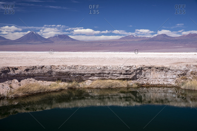 A small flooded sink hole in the Salar de Atacama, Los Flamencos National Reserve, Chile, South America