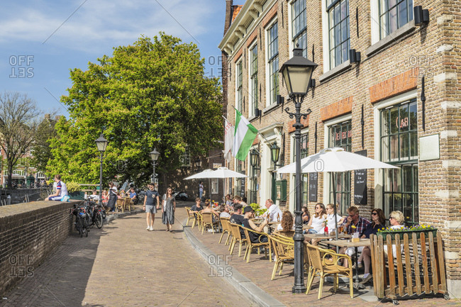 April 22, 2019: Street cafe, district of Delfshaven, Rotterdam, South Holland, Netherlands, Europe