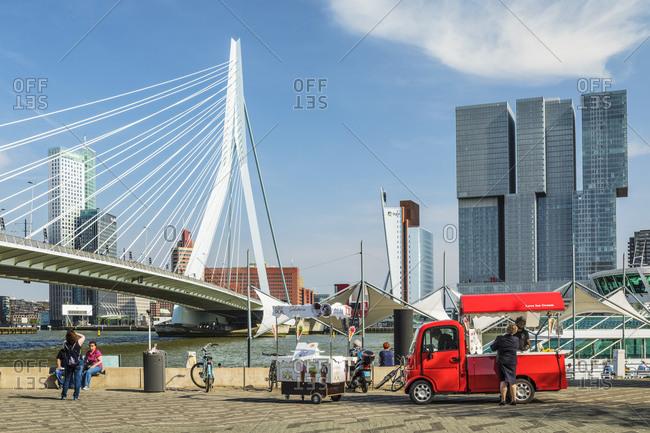 April 22, 2019: Nieuwe Maas River, Erasmus Bridge and Skyline, Rotterdam, South Holland, Netherlands, Europe
