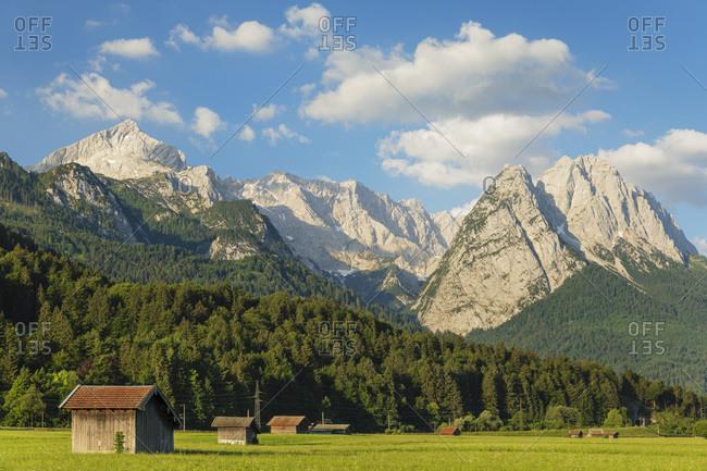 Hay barns at Hammersbach Footpath against Wetterstein Mountain Range, Garmisch-Partenkirchen, Werdenfelser Land, Upper Bavaria, Germany, Europe