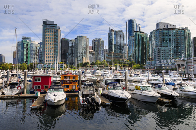 September 10, 2017: Marina at Coal Harbor, with leisure craft and house boats, city skyline, Vancouver, British Columbia, Canada, North America