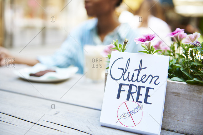 Gluten free' sign at pavement cafe