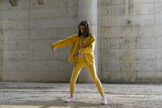 Woman wearing yellow jeans clothes- dancing