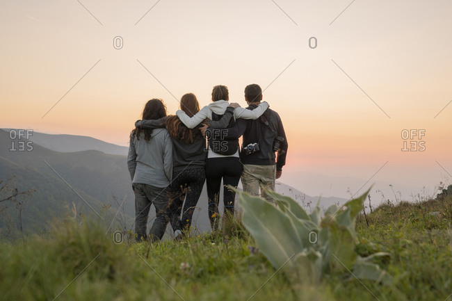 Bulgaria- Balkan Mountains- group of hikers standing on viewpoint at sunset