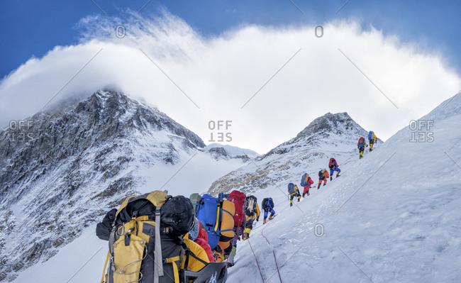 Nepal- Solo Khumbu- Everest- Sagamartha National Park- Roped team ascending- wearing oxygen masks