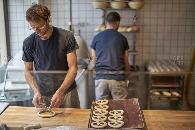 Bakers in bakery preparing fresh pretzels