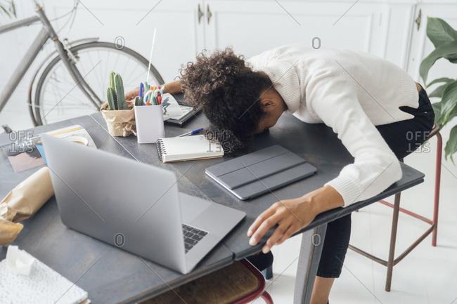 Tired freelancer sleeping on her desk