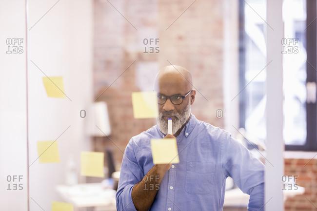 Portrait of pensive businessman in an office