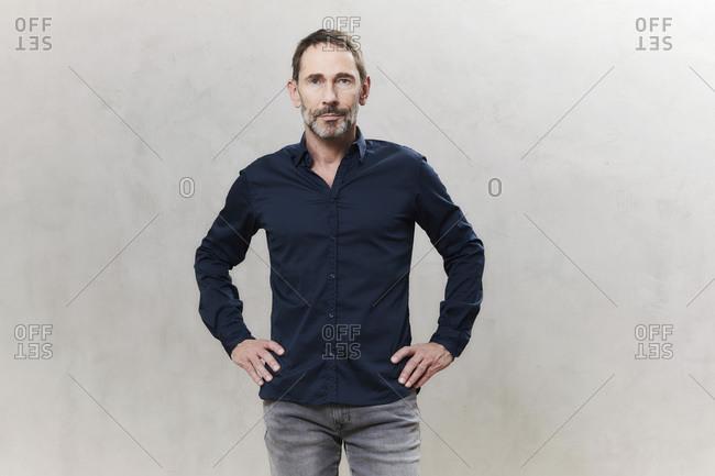 Portrait of businessman- dark blue shirt- waist up