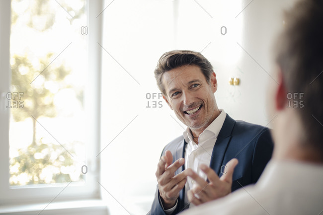 Successful businessman talking to colleague