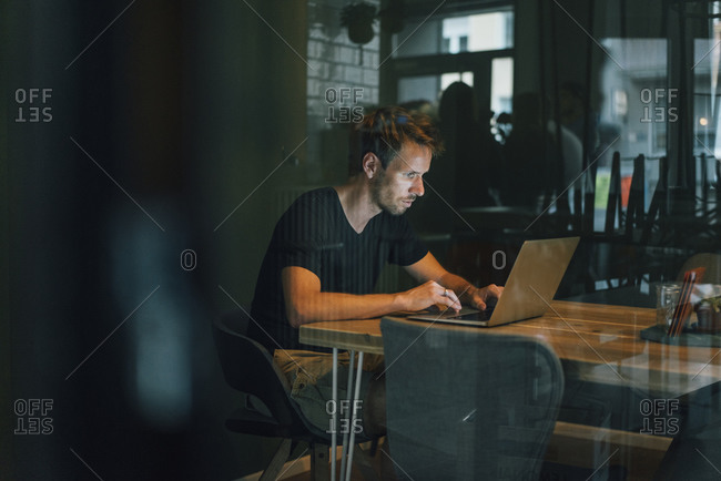 Man sitting in office- working late in his start-up company