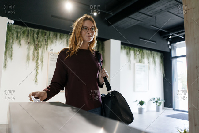Young woman entering spa area with chip card