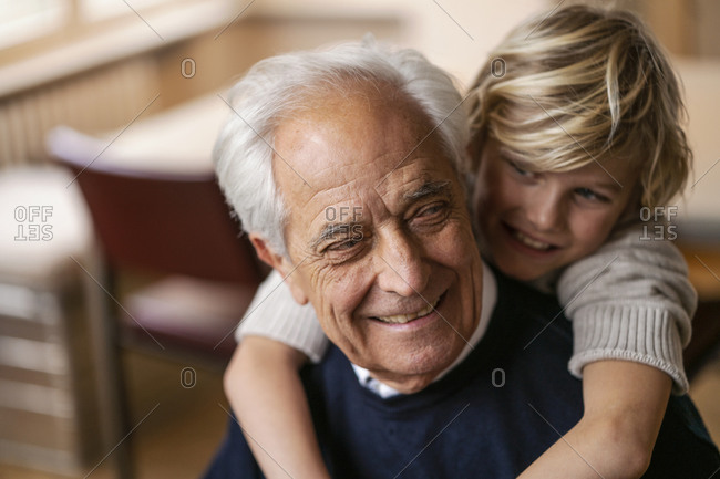 Happy grandson hugging grandfather