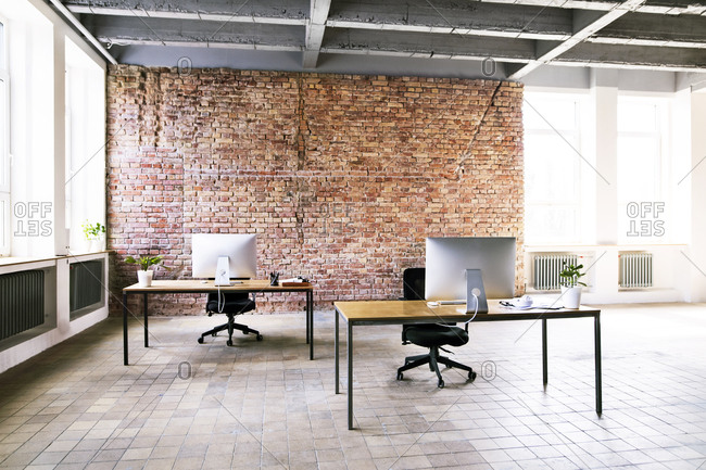 Coworking space with brick wall in office