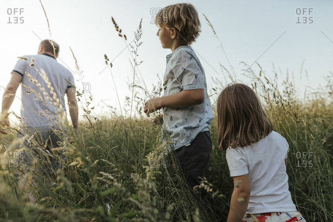 Siblings following their father in nature