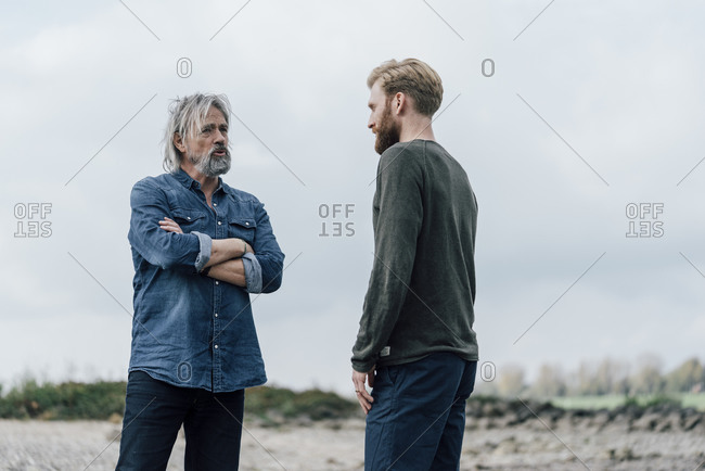 Father and son meeting outdoors- talking together