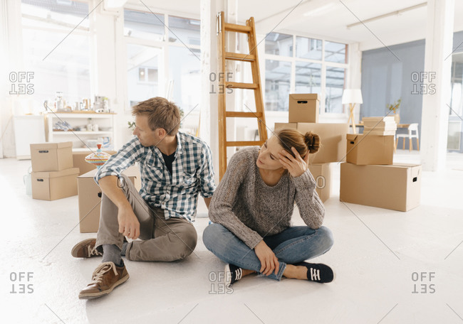 Couple moving into new home having a break