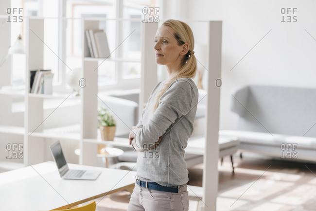 Woman standing in loft office