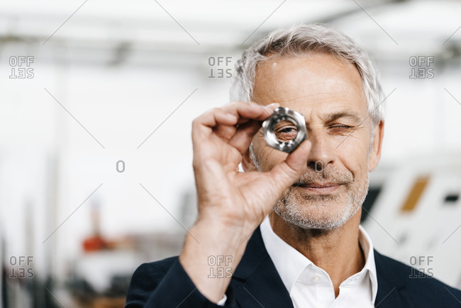 Manager in high tech enterprise- checking machine parts