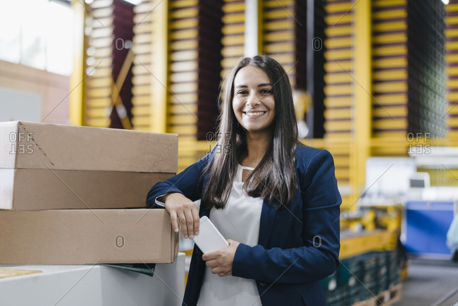 Young woman working in distribution warehouse