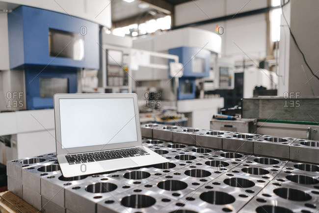 Laptop with blank screen in factory workshop