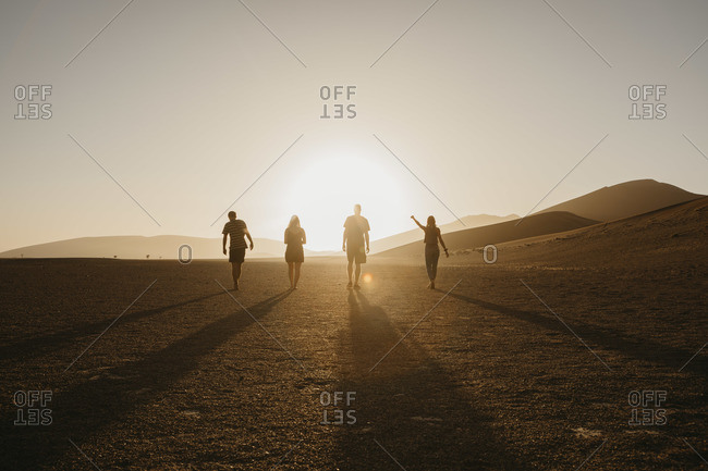 Namibia- Namib desert- Namib-Naukluft National Park- Sossusvlei- friends walking at Dune 45 at sunrise