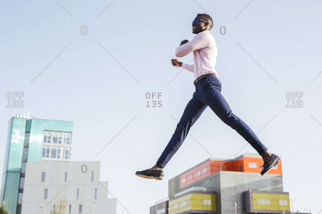 Young businessman jumping mid-air - from the Offset Collection