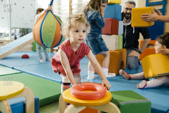Little girl playing in gym room of a kindergarten